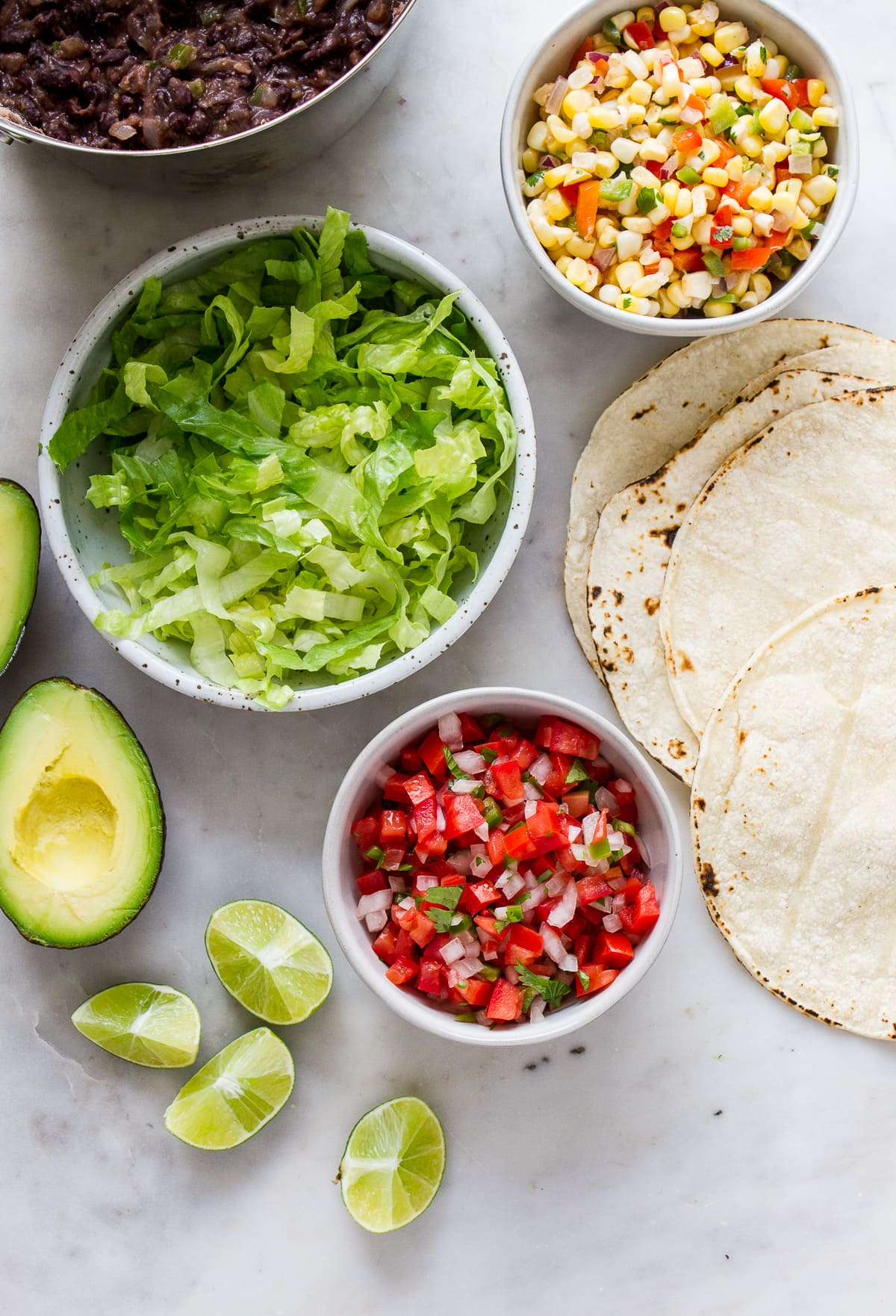 top down view of ingredients for vegan black bean tacos.