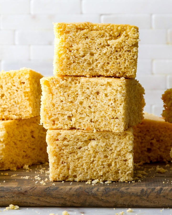 head on view of vegan cornbread stacked on each other.