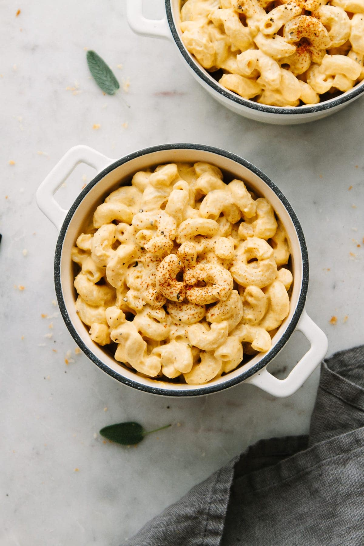 top down view of vegan butternut squash mac and cheese in a mini casserole.