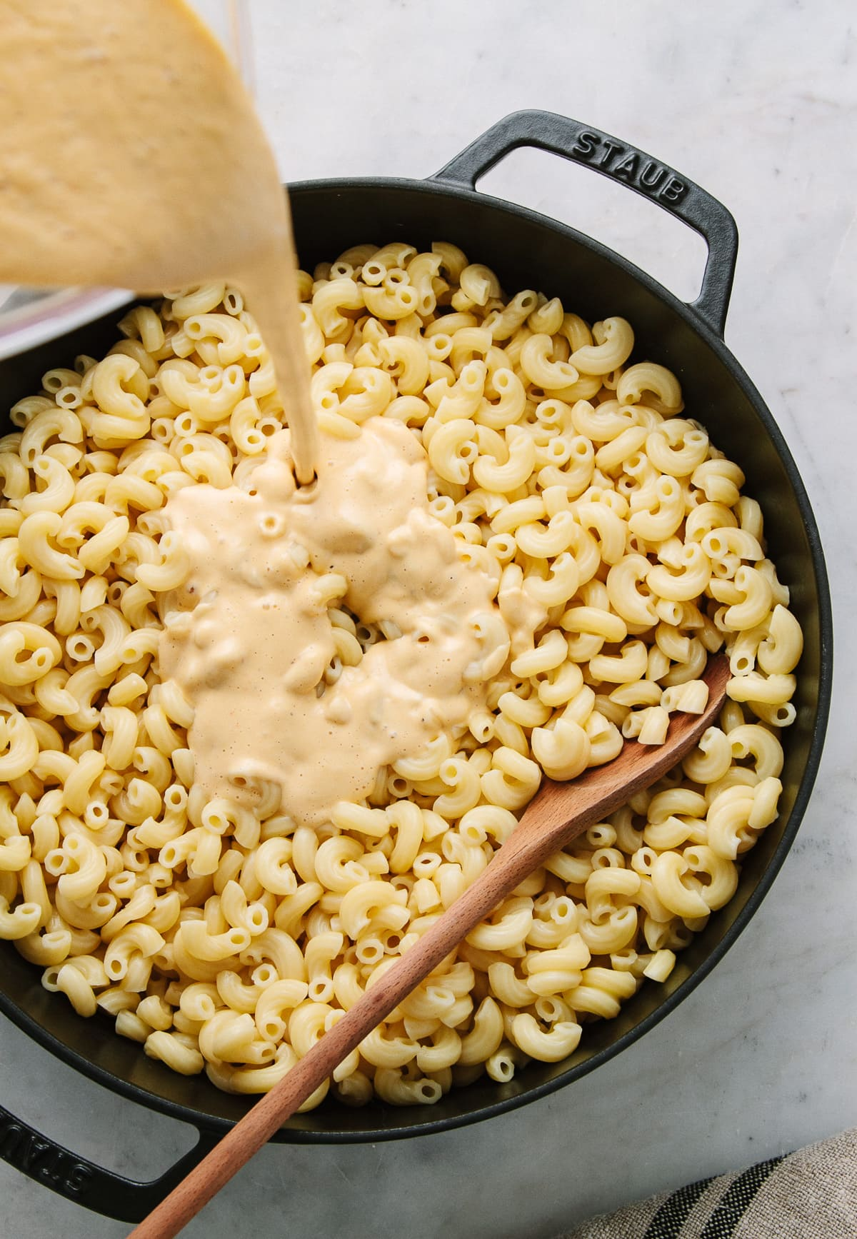 top down view of showing the process of making vegan butternut squash mac and cheese