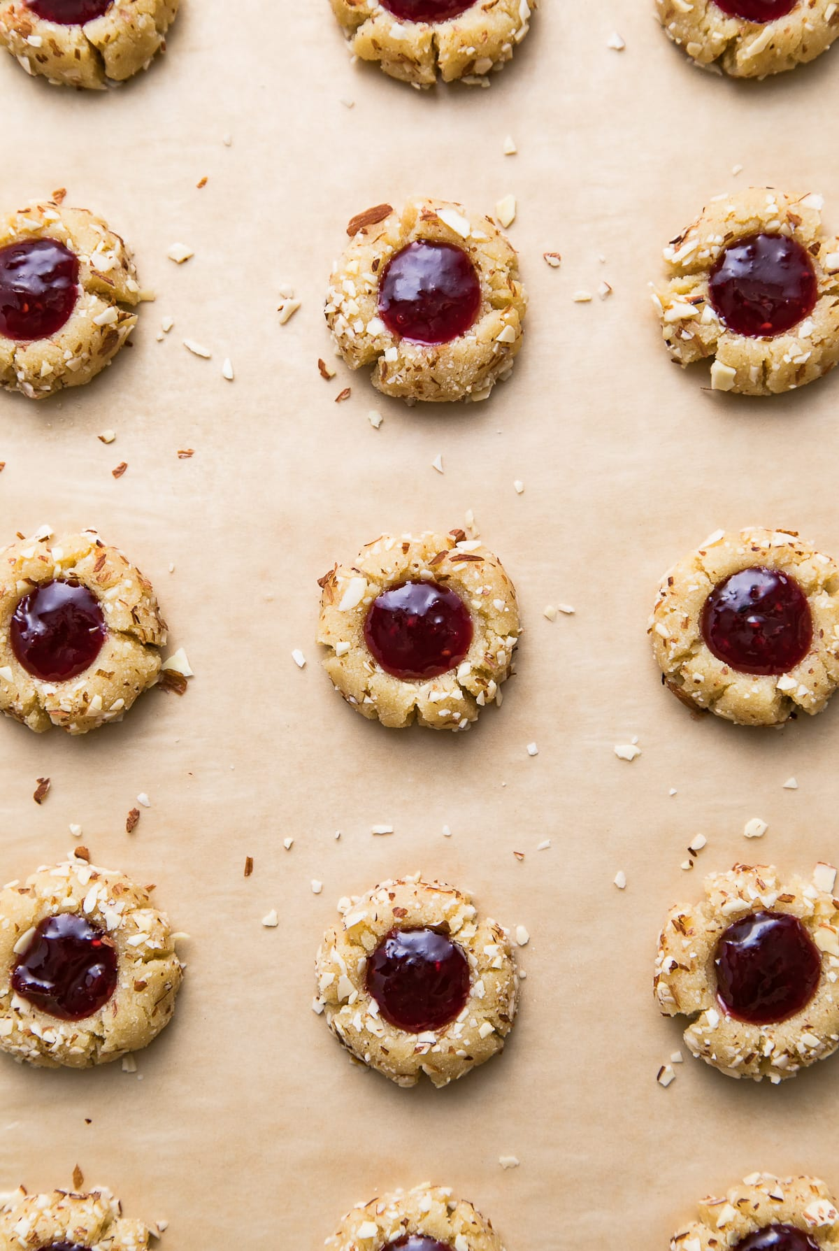 top down view of healthy almond thumbprint cookies on a baking sheet and ready for the oven.