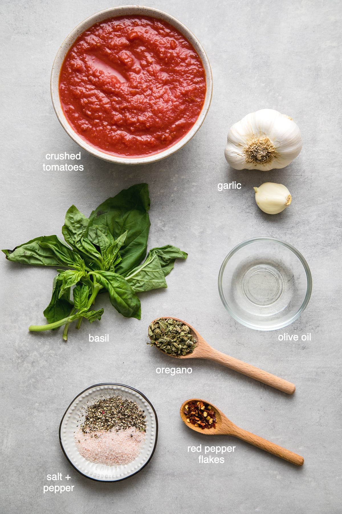 top down view of ingredients used to make the best homemade marinara sauce.