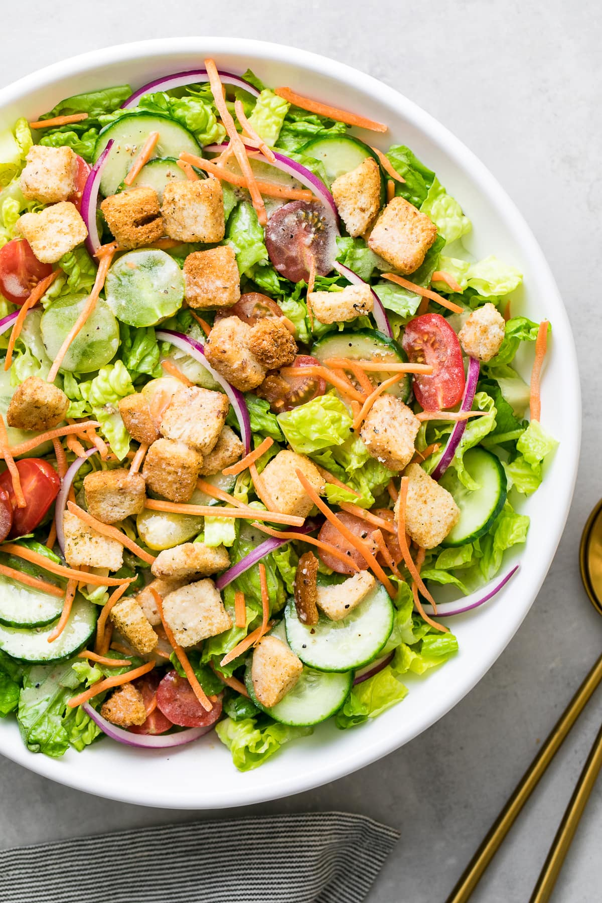 top down view of house salad with apple cider vinaigrette.