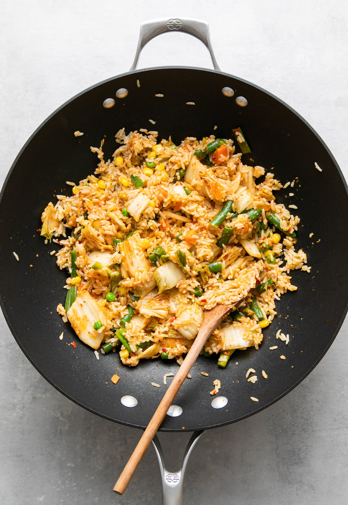 top down view of freshly made kimchi fried rice in a wok.
