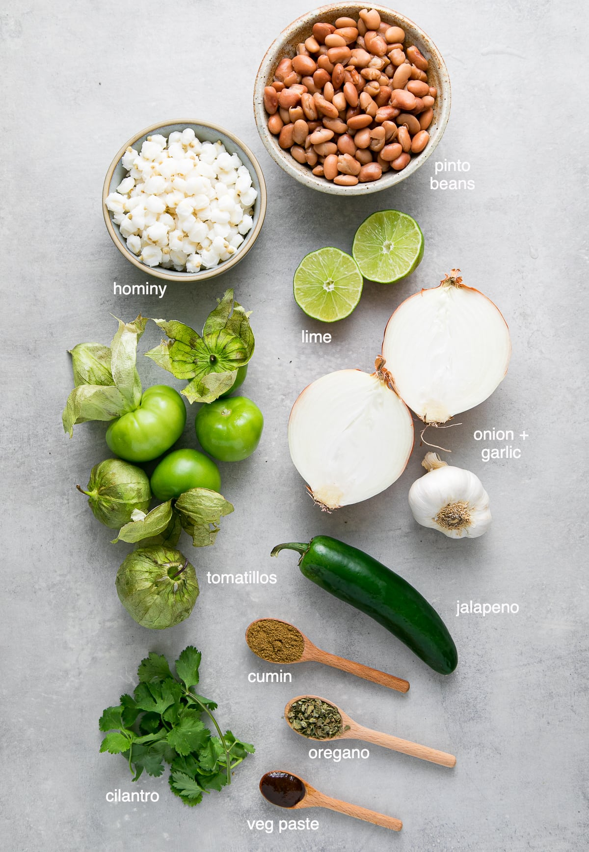 top down view of ingredients used to make posole verde with pinto beans and tomatillos.